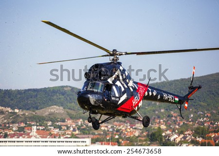 BUDAPEST HUNGARY - MAY 3:  A  Heliforce  aerobatic helicopter demonstrates different flying techniques, for civilian as well as some air force personnel on May 1 2014 Hungary.  - stock photo