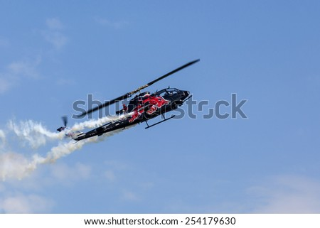 BUDAPEST HUNGARY - MAY 3:An Apache AH-64 demonstrate different flying techniques, for civilian as well as some air force personnel on May 1 2014 Hungary.  - stock photo