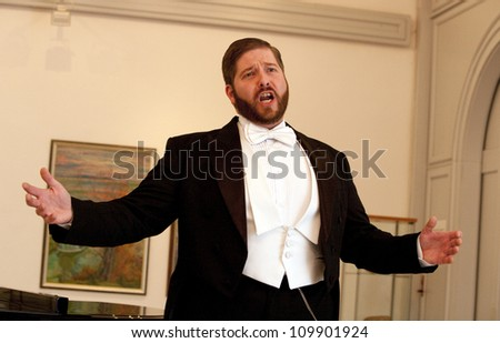 BUDAPEST, HUNGARY - MAY 07: Andras Barlay Hungarian opera and belcanto singer sings on his concert in the Budafok Museum on May 7, 2009 in Budapest, Hungary.