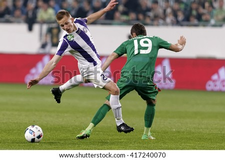 BUDAPEST, HUNGARY - MAY 7, 2016:  Benjamin Cseke (L) of Ujpest is fouled by Gabor Gyomber of Ferencvaros during the Hungarian Cup Final football match between Ujpest and Ferencvarosi at Groupama Arena - stock photo