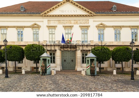 BUDAPEST, HUNGARY - MAY 9: Ceremonial guard at the Presidential Palace. They guard the entrance of the Presidents office in Budapest. May 9, 2014 in Budapest, Hungary. - stock photo