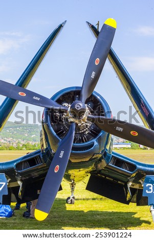 BUDAPEST, HUNGARY - MAY 1: Corsair historic fighter bomber plane fly-by with Red Bull marking on it's fuselage on May1, 2014 in Hungary  - stock photo
