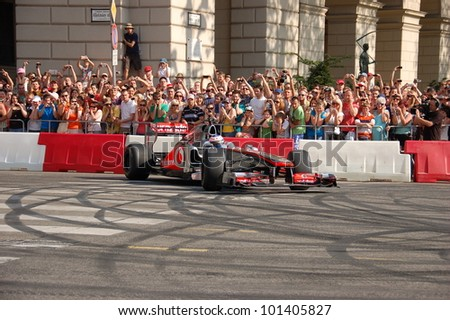 BUDAPEST, HUNGARY-  MAY 1: F1 driver Jenson Button does some burnouts for his fans on May 1, 2012 on streets in Budapest.