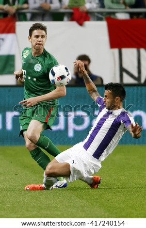 BUDAPEST, HUNGARY - MAY 7, 2016:  Laszlo Lencse (R) of Ujpest FC tries to tackle Zoltan Gera of Ferencvarosi TC during the Hungarian Cup Final match between Ujpest and Ferencvaros at Groupama Arena - stock photo