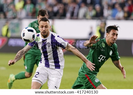 BUDAPEST, HUNGARY - MAY 7, 2016: Peter Kabat (L) of Ujpest fights for the ball with Leandro of Ferencvaros during the Hungarian Cup Final match between Ujpest and Ferencvarosi at Groupama Arena - stock photo