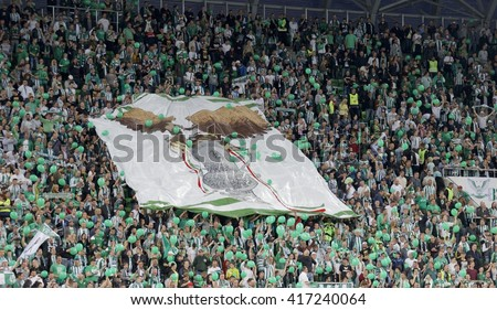 BUDAPEST, HUNGARY - MAY 7, 2016:  The supporters of Ferencvarosi TC during the Hungarian Cup Final football match between Ujpest FC and Ferencvarosi TC at Groupama Arena - stock photo