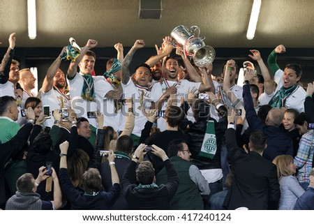 BUDAPEST, HUNGARY - MAY 7, 2016: The team of Ferencvarosi TC celebrate with the goblet during the Hungarian Cup Final football match between Ujpest FC and Ferencvarosi TC at Groupama Arena - stock photo