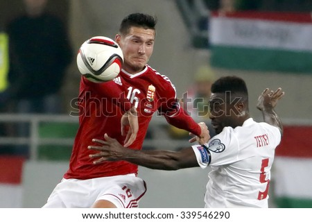 BUDAPEST, HUNGARY - NOVEMBER 15, 2015: Air battle between Hungarian Adam Pinter (l) and Norwegian Alexander Tettey during Hungary vs. Norway UEFA Euro 2016 qualifier play-off match at Groupama Arena. - stock photo