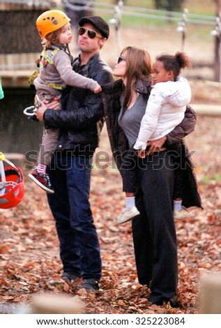 BUDAPEST, HUNGARY - NOVEMBER 5, 2010: Brad Pitt and Angelina Jolie take their children Pax, Zahara and Shiloh to a park in Budapest. - stock photo
