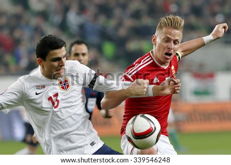 BUDAPEST, HUNGARY - NOVEMBER 15, 2015: Duel between Hungarian Balazs Dzsudzsak (r) and Norwegian Mohamed Elyounoussi during Hungary vs. Norway UEFA Euro 2016 qualifier play-off match at Groupama Arena - stock photo