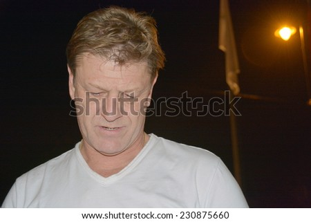 BUDAPEST, HUNGARY-  NOVEMBER 14: English actor Sean Bean arrives to Budapest filming 'The Martian' and signing autographs on November 14, 2014 in Budapest. - stock photo