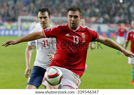 BUDAPEST, HUNGARY - NOVEMBER 15, 2015: Hungarian Daniel Bode (r) covers the ball from Norwegian Vegard Forren during Hungary vs. Norway UEFA Euro 2016 qualifier football match at Groupama Arena.