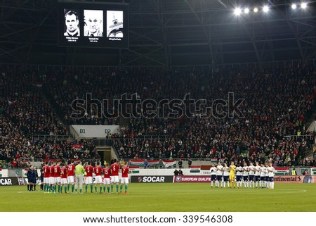 BUDAPEST, HUNGARY - NOVEMBER 15, 2015: Hungarian, Norwegian teams and the crowd remember of the victims of terror in Paris during Hungary vs. Norway UEFA Euro 2016 qualifier match at Groupama Arena. - stock photo