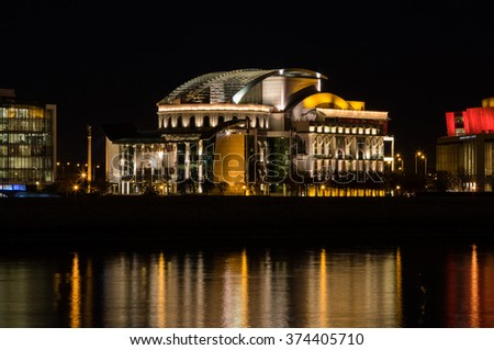 BUDAPEST, HUNGARY - NOVEMBER, 2015: National Theatre of Budapest, Hungary - Night shot with reflections on River Danube, November 16, 2015. - stock photo
