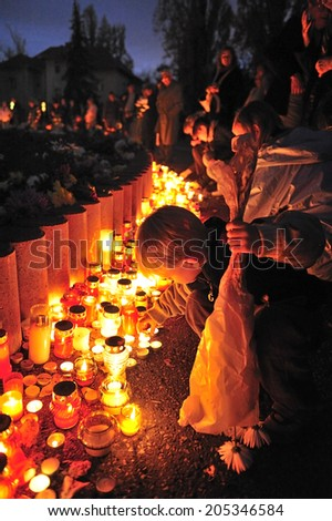 BUDAPEST, HUNGARY -  November. 1. 2008: people come to pray at the cemetery with candles during All Saints Day, Budapest, Hungary