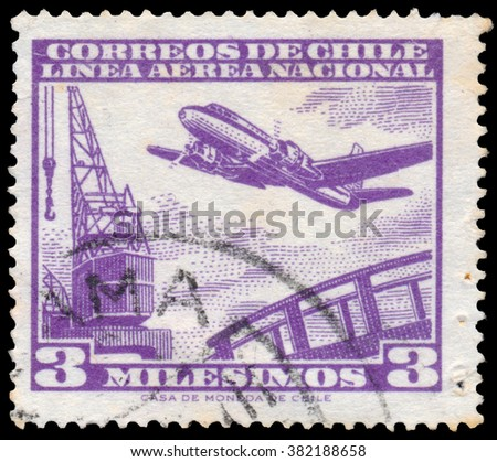 BUDAPEST, HUNGARY - 14 october 2015: a stamp printed in Chile shows plane, circa 1960 - stock photo