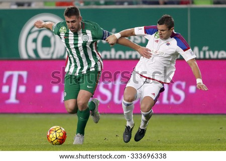 BUDAPEST, HUNGARY - OCTOBER 31, 2015: Duel between Daniel Bode of Ferencvaros (l) and an unidentified player of Vasas during Ferencvaros vs. Vasas OTP Bank League football match in Groupama Arena.  - stock photo