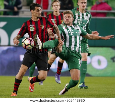 BUDAPEST, HUNGARY - OCTOBER 22, 2016: Florian Trinks (R) of Ferencvaros duels  with Davide Lanzafame (L) of Budapest Honved during Ferencvaros v Budapest Honved OTP Bank Liga match at Groupama Arena.