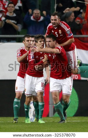 BUDAPEST, HUNGARY - OCTOBER 8, 2015: Hungarian Daniel Bode (13) celebrates his first goal with his teammates during Hungary vs. Faroe Islands UEFA Euro 2016 qualifier football match in Groupama Arena. - stock photo