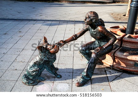 BUDAPEST, HUNGARY - OCTOBER 30, 2016: Street sculptures. Statue of girl with dog