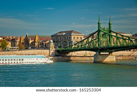 BUDAPEST, HUNGARY - 23 OCTOBER, 2013: The famous Liberty Bridge in sunset in Budapest. The Liberty Bridge is the third southernmost public road bridge in Budapest.