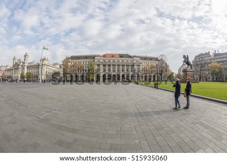 BUDAPEST, HUNGARY- OCTOBER 30 2016: Tourists on the Kossuth square in the downtown. Budapest is the capital and the largest city of Hungary, and one of the largest cities in the European Union.