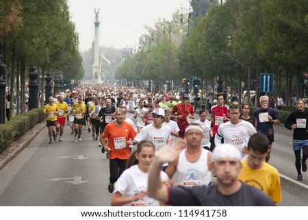 BUDAPEST, HUNGARY - OCTOBER 7: unidentified marathon runners at SPAR Budapest International Marathon with the heroes square in the background on October 7, 2012 in Budapest, Hungary - stock photo