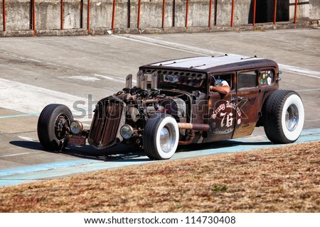 BUDAPEST, HUNGARY - SEPT 15: a hot rod on display at the Velodrom Millenaris Old Timer Expo  on September 15, 2012 in Budapest, Hungary - stock photo