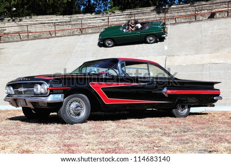 BUDAPEST, HUNGARY - SEPT 15: an American car named Chevrolet Impala 2nd generation on display at the Velodrom Millenaris Old Timer Expo  on September 15, 2012 in Budapest, Hungary - stock photo