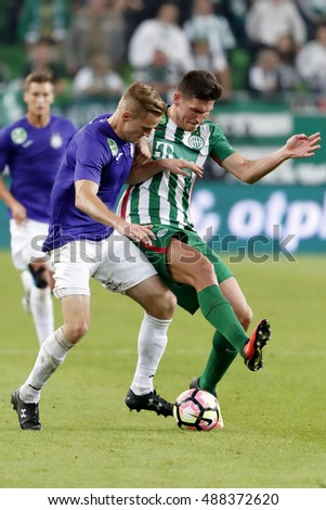 BUDAPEST, HUNGARY - SEPTEMBER 24, 2016: Adam Pinter (R) of Ferencvarosi TC fights for the ball with Benjamin Cseke (L) of Ujpest FC during Ferencvaros v Ujpest FC OTP Bank Liga match at Groupama Arena