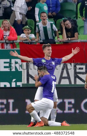 BUDAPEST, HUNGARY - SEPTEMBER 24, 2016: Balazs Balogh (L) celebrates his goal with Viktor Angelov #17 of Ujpest during Ferencvaros v Ujpest FC OTP Bank Liga match at Groupama Arena