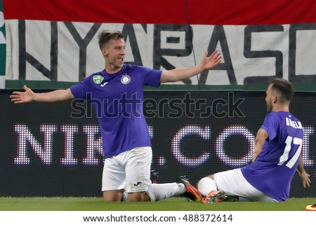 BUDAPEST, HUNGARY - SEPTEMBER 24, 2016: Balazs Balogh (L) of Ujpest FC celebrates his goal with Viktor Angelov #17 of Ujpest FC during Ferencvaros v Ujpest FC OTP Bank Liga match at Groupama Arena
