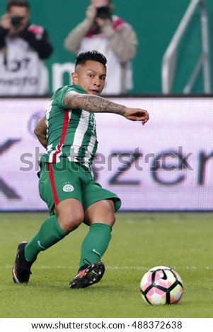 BUDAPEST, HUNGARY - SEPTEMBER 24, 2016: Cristian Ramirez of Ferencvarosi TC crosses the ball during Ferencvaros v Ujpest FC OTP Bank Liga match at Groupama Arena