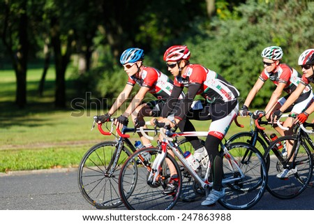 Budapest, Hungary, September 12 2014: Cyclists riding bicycles in a park near the Castle Vajdahunyad in Budapest  - stock photo