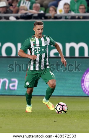 BUDAPEST, HUNGARY - SEPTEMBER 24, 2016: Dominik Nagy of Ferencvarosi TC controls the ball during Ferencvaros v Ujpest FC OTP Bank Liga match at Groupama Arena