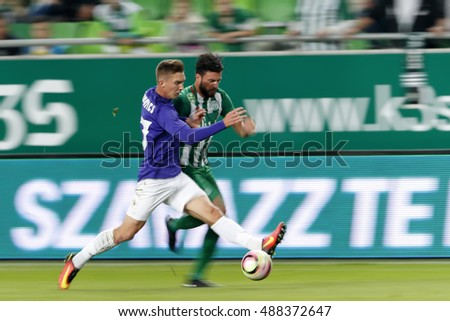 BUDAPEST, HUNGARY - SEPTEMBER 24, 2016: Marco Djuricin (R) of Ferencvaros duels for the ball with Bence Pavkovics (L) of Ujpest FC during Ferencvaros v Ujpest FC OTP Bank Liga match at Groupama Arena
