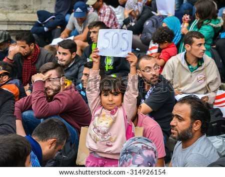 BUDAPEST, HUNGARY - SEPTEMBER 5, 2015 : Refugees at the Keleti Railway Station on 5 September 2015 in Budapest, Hungary. Refugees are arriving constantly to Hungary on the way to Germany. - stock photo