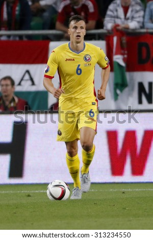 BUDAPEST, HUNGARY - SEPTEMBER 4, 2015: Romanian Vlad Chiriches with the ball during Hungary vs. Romania UEFA Euro 2016 qualifier football match in Groupama Arena. - stock photo