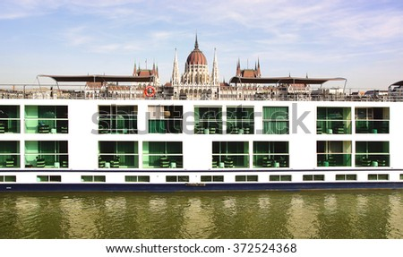 BUDAPEST, HUNGARY - SEPTEMBER 30, 2014: Scenic Crystal ship on the background of the Hungarian Parliament. Cruise on Danube River in Europe is the Scenic Crystal Scenic Space-ship. Built in 2012 - stock photo