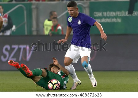 BUDAPEST, HUNGARY - SEPTEMBER 24, 2016: Seung-Woo Ryu (L) of Ferencvaros lies on the ground next to Enis Bardhi (R) of Ujpest FC during Ferencvaros v Ujpest FC OTP Bank Liga match at Groupama Arena