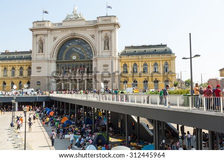BUDAPEST, HUNGARY - SEPTEMBER 01: Stranded Refugees and Migrants camp in front of the eastern Train Station Keleti Palyudvar on September 01, 2015 in Budapest, Hungary.  - stock photo