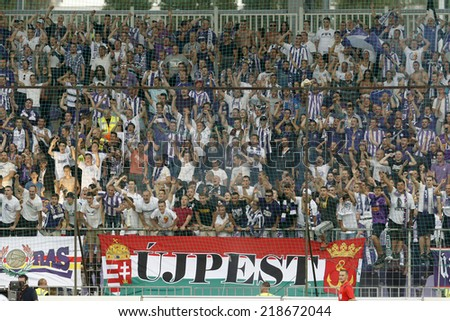 BUDAPEST, HUNGARY - SEPTEMBER 21, 2014: Supporters of Ujpest celebrate their team's second goal during Ujpest vs. Ferencvaros OTP Bank League football match at Szusza Stadium.  - stock photo