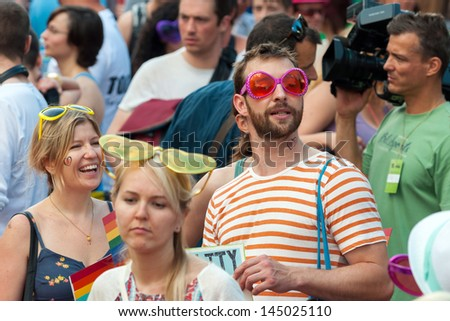 BUDAPEST, JULY 06: Unidentified people participate at the 18th Budapest Pride on 06 July 2013 in Budapest, Hungary. The Budapest Pride in one of the popular gay parades in Europe. - stock photo