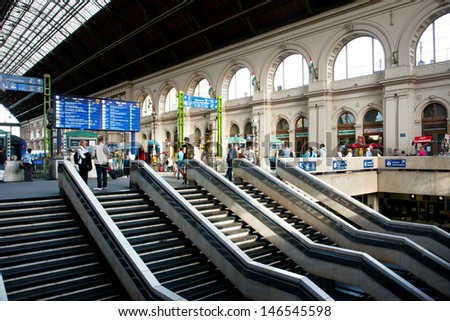 BUDAPEST - MAY 29: Many passengers walk inside Keleti railway station at the sunny day on 29 May 2013 in Budapest, Hungary. The main international railway terminal in Budapest was constructed in 1884