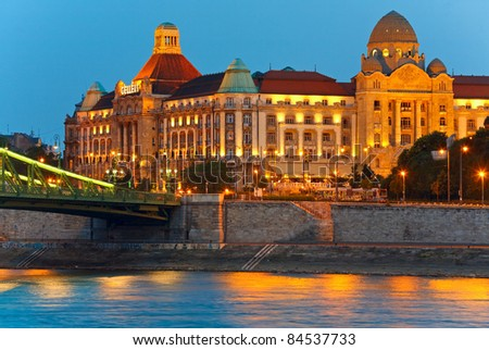 Budapest night view. Long exposure. Hungarian landmarks, Freedom Bridge fragment and Gellert Hotel Palace (built between 1912 and 1918, all peoples is unrecognizable) - stock photo