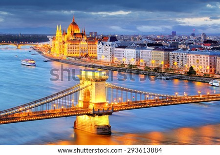 Budapest, night view of Chain Bridge on the Danube river and the city of Pest - stock photo