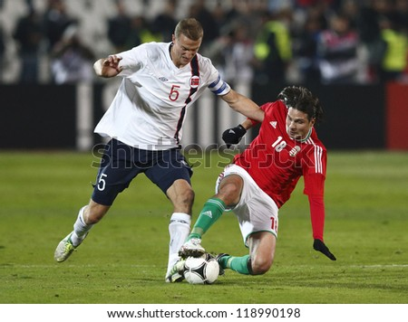 BUDAPEST - NOVEMBER 14: Hungarian Imre Szabics (R) and Norse Brede Hangeland during Hungary vs. Norway friendly football game at Puskas Stadium on November 14, 2012 in Budapest, Hungary. - stock photo