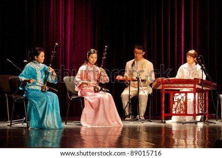 """BUDAPEST - NOVEMBER 13: Members of the Nanjing Chinese Traditional Orchestra perform on concert at """"Urania"""" Budapest Nov 13, 2011 in Budapest, Hungary. - stock photo"""
