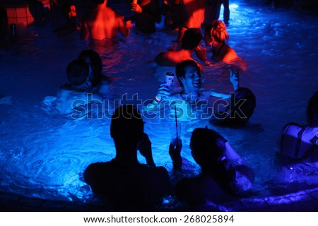 BUDAPEST - NOVEMBER 2, 2013: Tourists enjoy the Magic Bath Party at the Lukacs Bath, a traditional night party in a historic outdoor thermal bath heated naturally by hot springs, in Budapest, Hungary.
