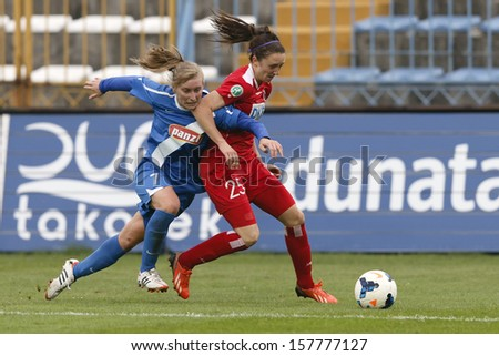 BUDAPEST - OCTOBER 10: Duel between Henrietta Csiszar of MTK (L) and Lisa Evans of Potsdam during MTK vs. Potsdam football match at Hidegkuti Stadium on October 10, 2013 in Budapest, Hungary.